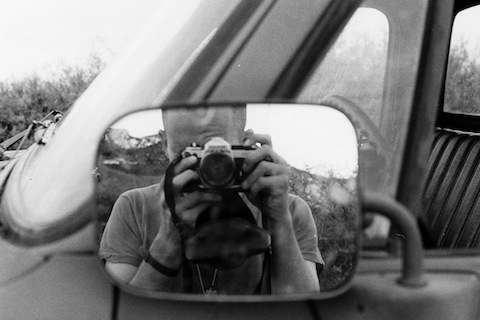 Arty -- so to speak 😉 -- selfie with my Nikon FE2, back when I used a real camera.