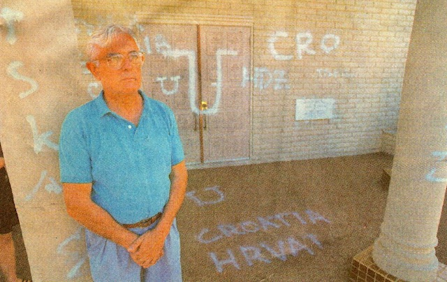 Vlado Brodich, president of the board of directors at St. Sava Serbian Orthodox Church, near 44th and McKinley streets, found Croatian profanities spray-painted on the church Friday morning. (Michael Ging/Staff photographer)