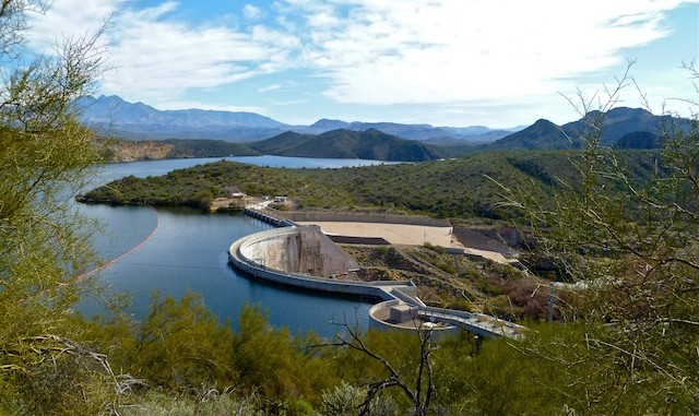 Stewart Mountain Dam holds back the Salt River, creating Saguaro Lake. Four Peaks in the distant (left).
