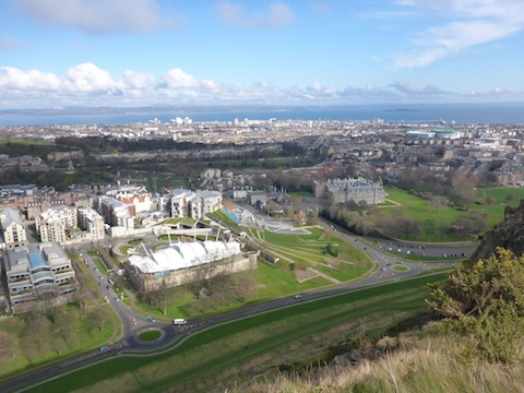 Looking down at the Scottish Parliament, Holyrood House, and across Leith to Easter Road.