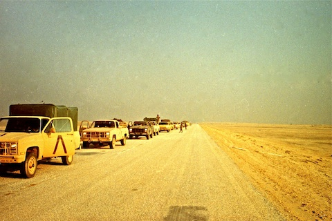 Convoy stopped in the desert somewhere south of Khafji.