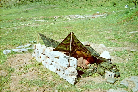 Me in my base camp hooch. Looking east, across the road, at our LZ.