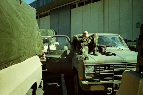 2LT McMurry sleeping on his truck.