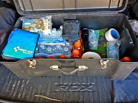 Off roading emergency kit: First aid, entrenching tool, toilet paper, hand cleanser, duct tape, flashlight, spare batteries, woobie, energy bars, case of water and case of Gatorade.