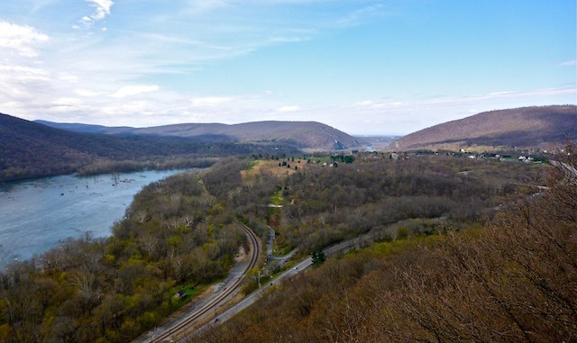 Looking west, across the Potomac River, from the top of Weverton Cliffs. Harpers Ferry is near the bottom of Blue Ridge in the distant middle. The Maryland Heights on the right.