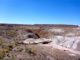 Looking down at the Onyx Bridge, across the Lithodendron Wash basin to the unnamed mesa, on which you can see the Painted Desert Inn.