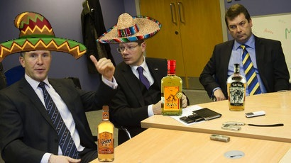 Stewart Regan & Neil Doncaster wearing sombreros and drinking tequila.