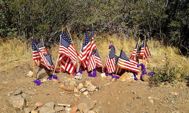 19 flags and a fire truck for he fallen Granite Mountain Hotshots.