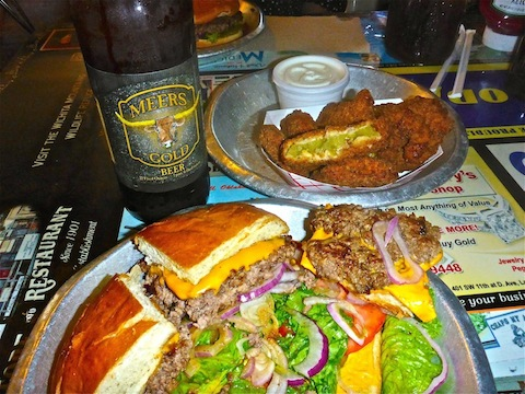 A massive plate-sized Meersburger, with a side of fried green tomatoes, and a Meers Gold Beer.