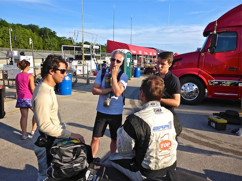 Post-race BAR1 debrief, with Bruno Junquiera, Chris McMurry, team owner Brian Alder (seated) and Matt McMurry.