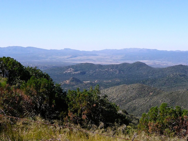Looking south across Copper Basin to Peeples Valley. Antelope Peak is the flat spot left of the pass (in the middle); Yarnell Hill the mass to the right of the pass.
