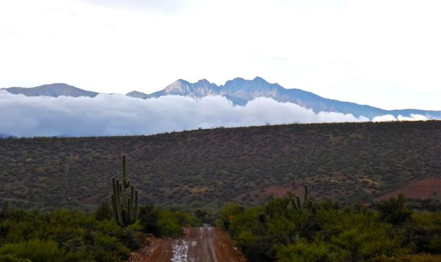 Looking from A-Cross Ranch Road, towards cloud-obscured Four Peaks.