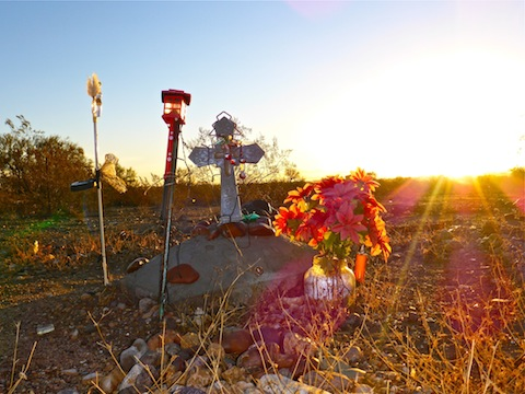 The morning sun shines on Gabby's roadside memorial on Old Highway 80.