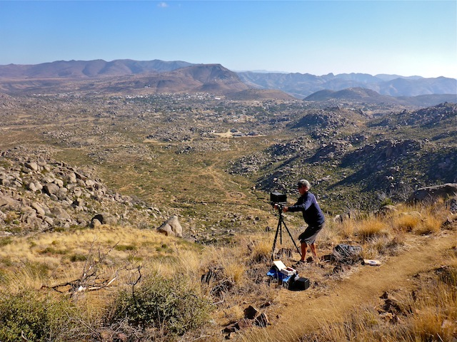 Paul setting up his large format camera, near the observation deck, basically in the same location as the featured image. The circle is the fatality site. Yarnell & Glen Ilah are in the distance. Note how quickly the vegetation has returned.