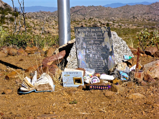 Mementos left at the base of the flag pole.