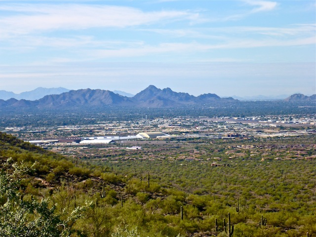 Looking southwest from Windgate Pass Trail, past WestWorld of Scottsdale (middle left) and Scottsdale Airport (middle right), towards Piestewa Peak. 13 miles distant.