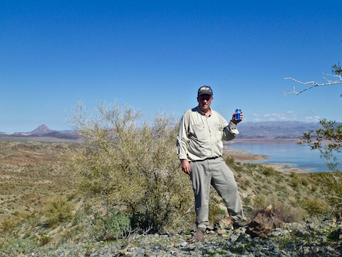 """Enjoying"" a Bud Light on Hill 1655. Artillery Peak on the left; Alamo Lake below."