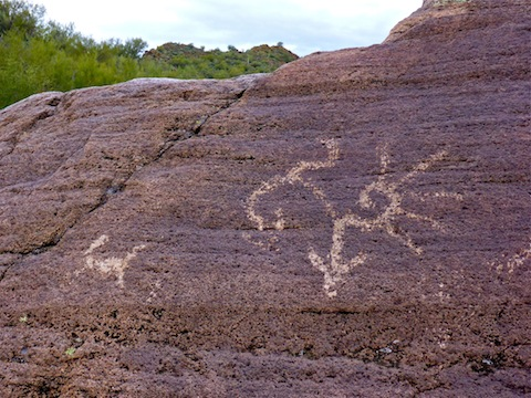 The petroglyph on the left is a deer. I have no clue what the psychedelic design is on the right.