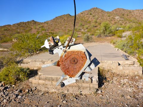"This ""artifact"" looks like an old turntable. The largest bulilding in the ghost town in the background."