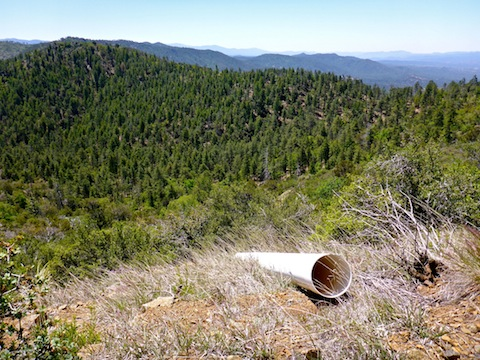 This PVC pipe served as a sluice / ore chute for wildcatters back in the 1970s. Williams Peak on the far side of the canyon.