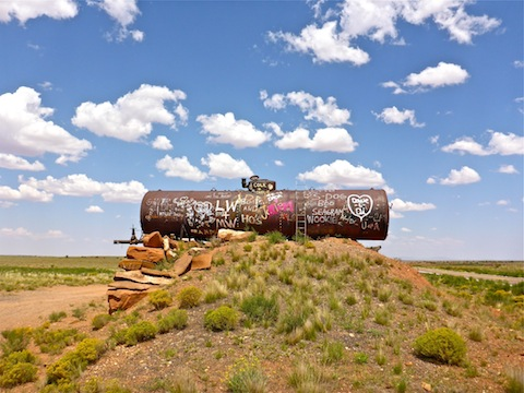Graffiti-covered tank in the middle of nowhere south of Winslow.