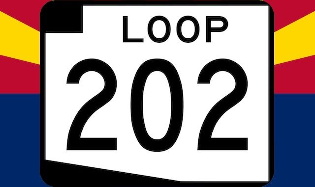 Loop 202 South Mountain Freeway sign on Arizona flag backgroound.