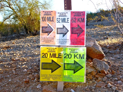 Trail running signs.