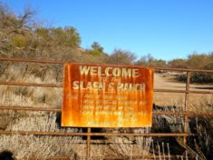 """Welcome to Slash S Ranch"" sign on Dripping Springs Rd."