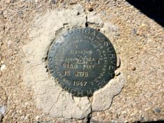 "Pioneer Pass benchmark is cemented in the curb of the cattle guard. Any idea what ""13 JDB"" means?"
