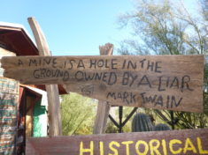 "Sign outside the Blue Bird Cafe: ""A mine is a hole in the ground owned by a liar."" (Mark Twain)"